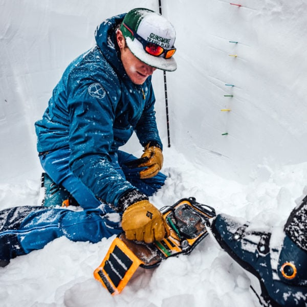 An instructor points out layers in the snowpack during an AIARE Level 2 Avalanche Training course in Colorado.