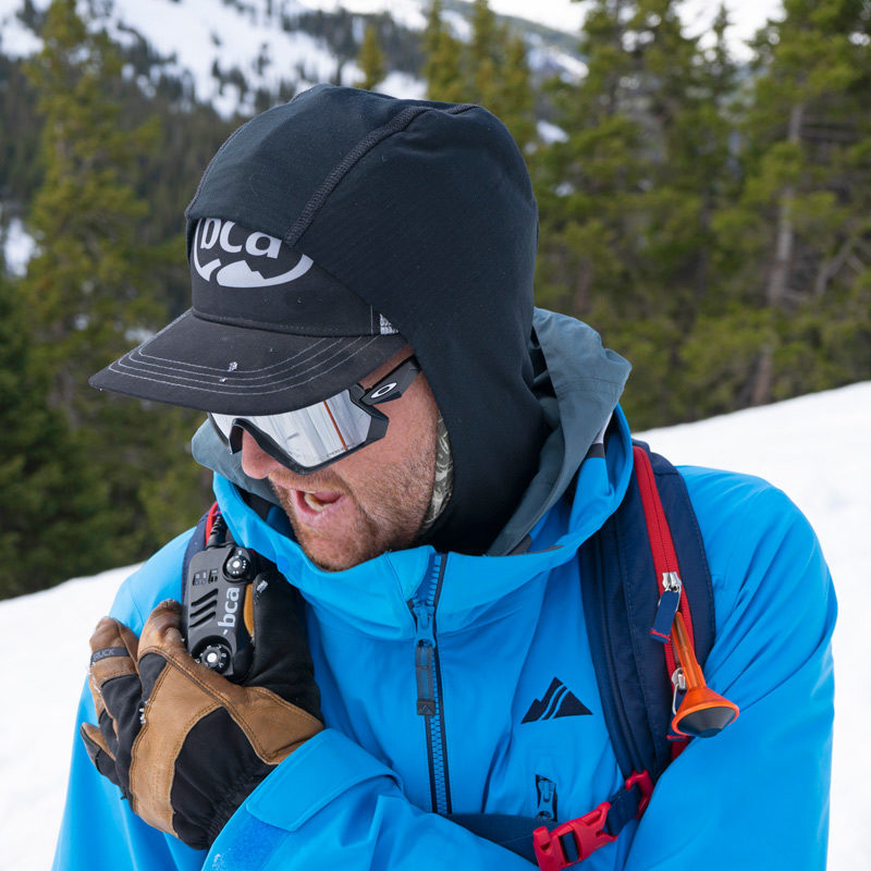 A student on an AIARE 2 course in Colorado performs a radio check.