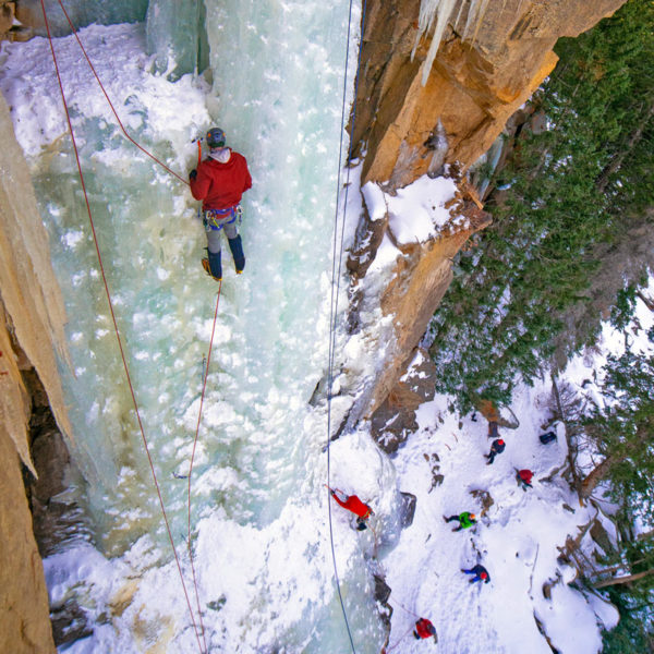 A student learns to lead ice climbs during a lesson on an ice climbing course near Denver, Colorado.