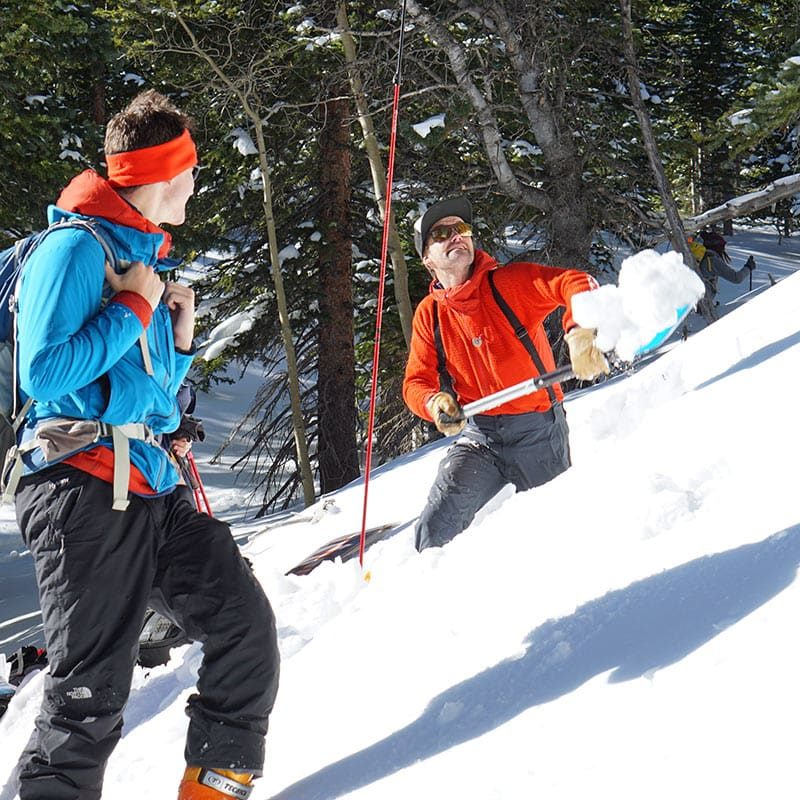 Colorado Mountain School instructor, Ian Fowler, digs a snow study pit in preparation for a lesson on an AIARE Level 2 avalanche course in Colorado.