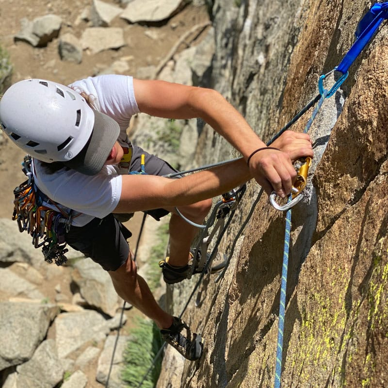 A climber practices following an aid pitch during a big wall climbing course in Colorado.