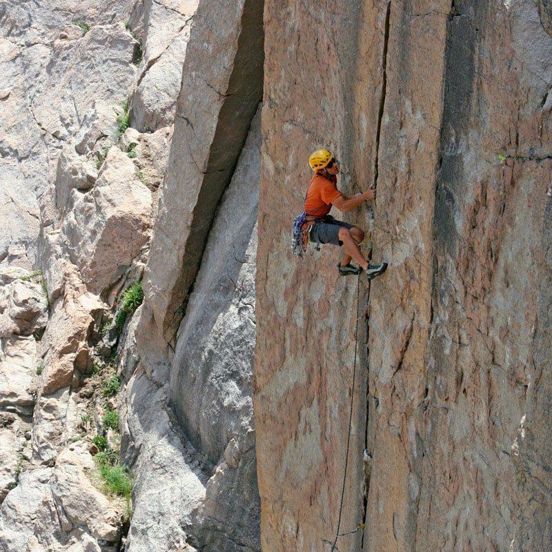 Colorado Mountain School Guide, Buster Jesik, laybacks his way up a crack climb.