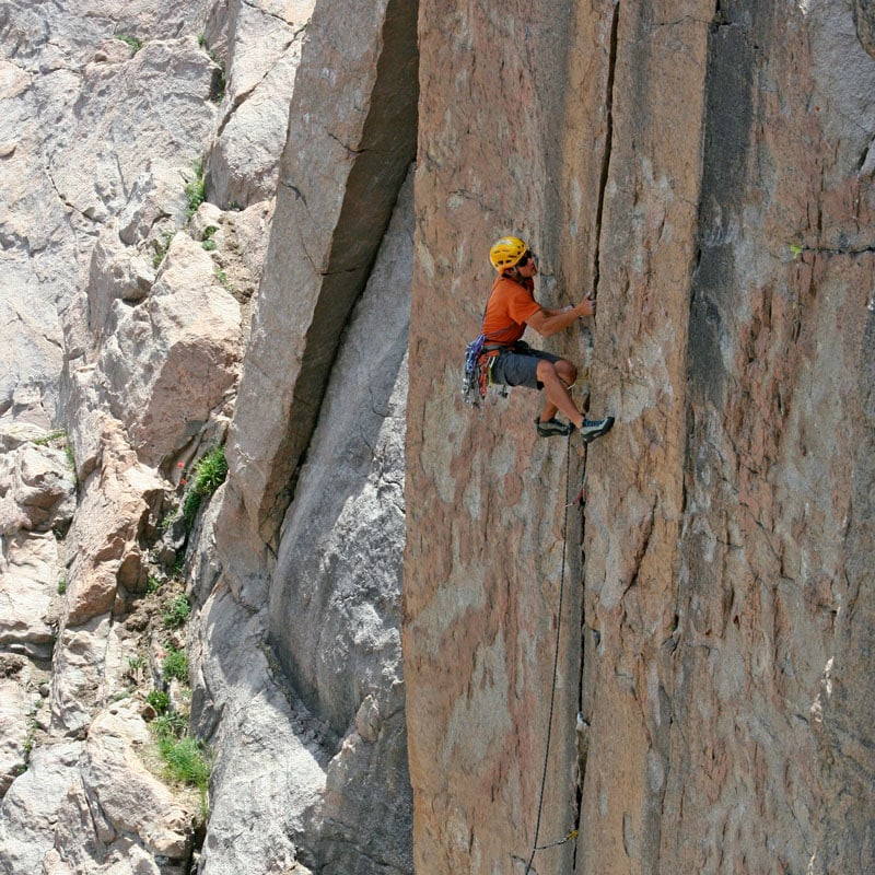 Colorado Mountain School Guide, Buster Jesik, laybacks his way up a crack climb.