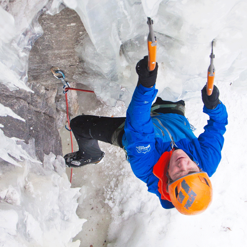A student on an ice climbing course leads a pitch on a frozen waterfall just outside of Vail, Colorado.