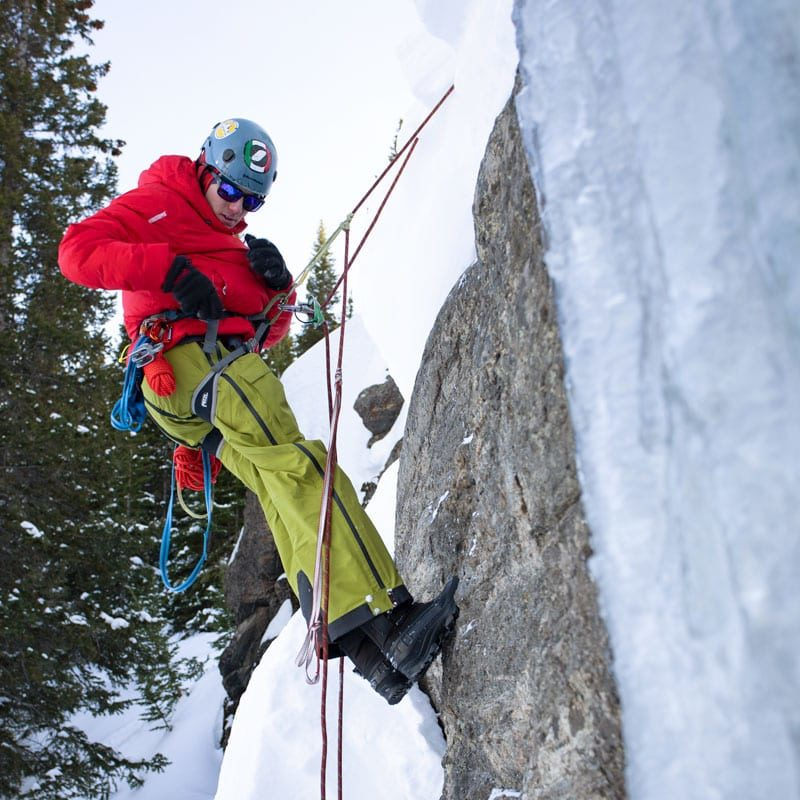 A student practices ascending a fixed rope during a crevasse rescue scenario in Rocky Mountain National Park.