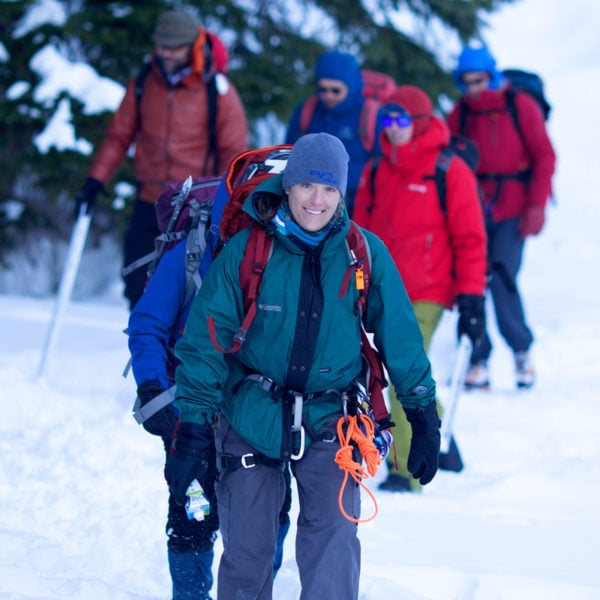 A group of students hike into Rocky Mountain National Park during a Crevasse Rescue course.