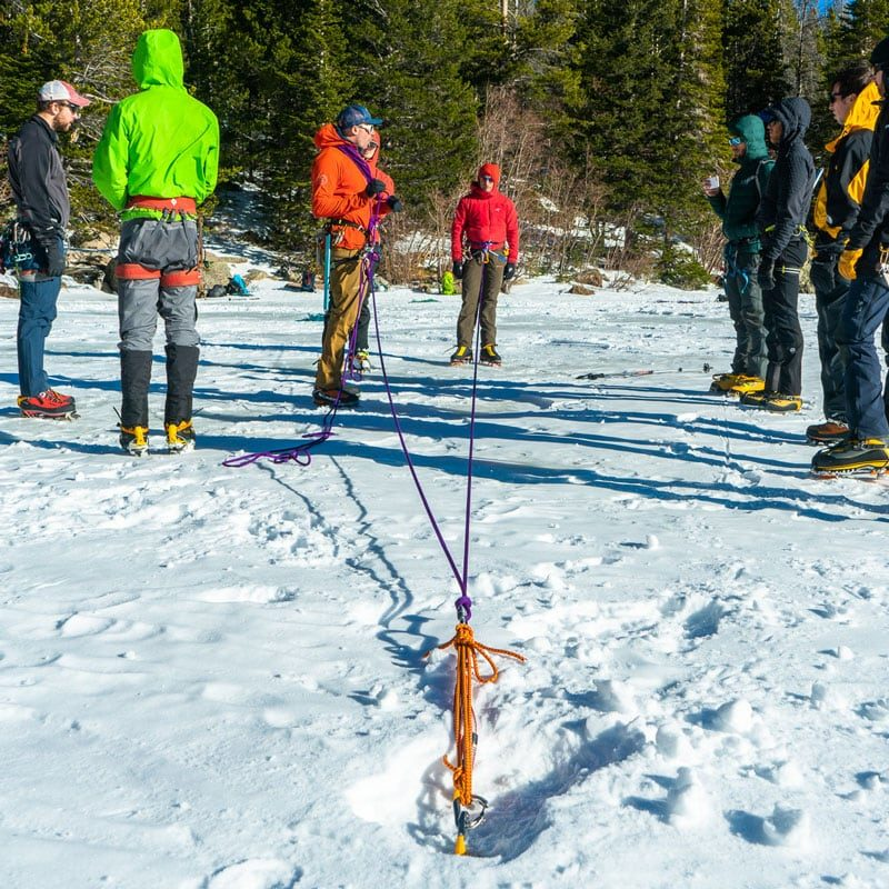 Instructors teach a Crevasse Rescue course to students on a frozen lake in Rocky Mountain National Park, Colorado.