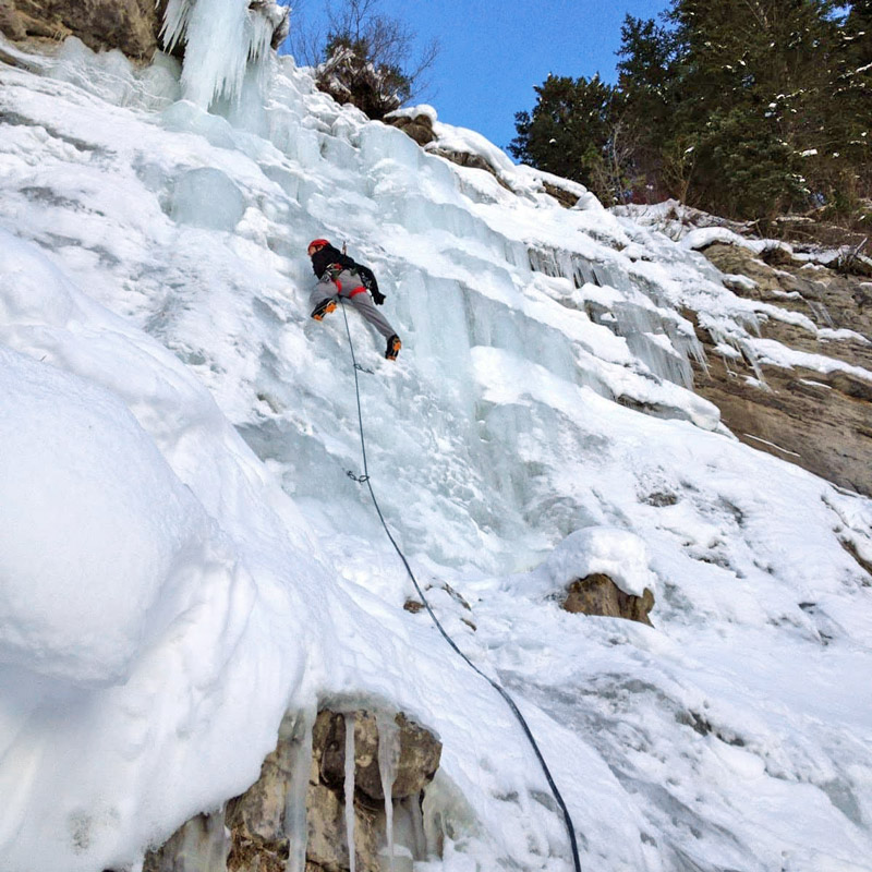 An ice climber leads up a nearly vertical ice flow near Denver, Colorado.