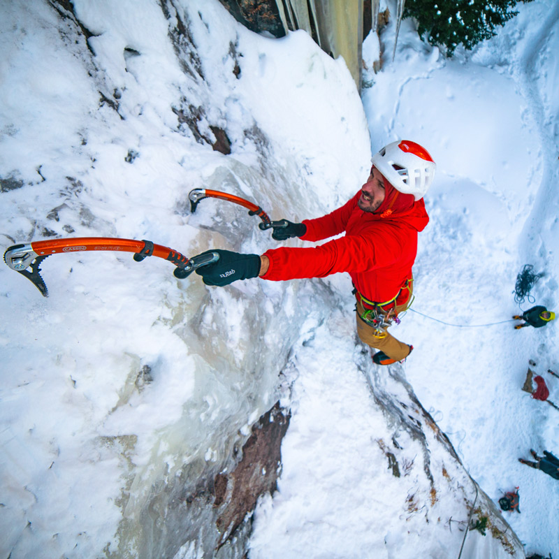 An ice climber picks his way up a vertical ice climb in Rocky Mountain National Park, Colorado.