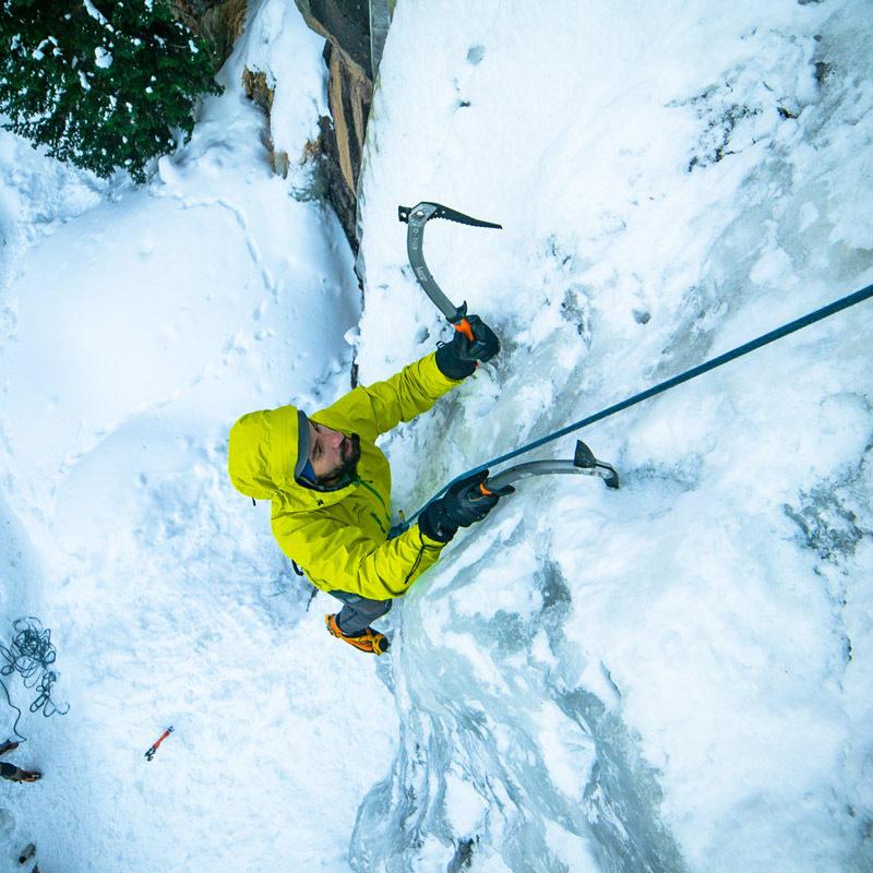 A ice climber picks his way up a frozen waterfall during a Vertical Ice Climbing course near Estes Park, Colorado.