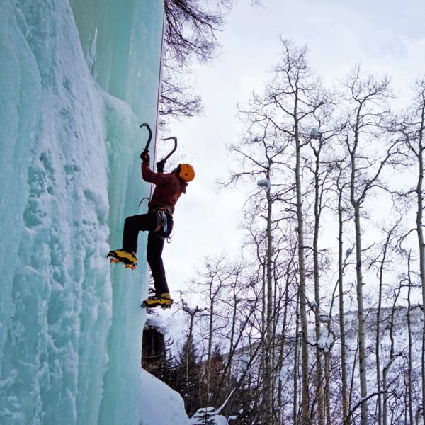 An ice climber kicks his crampons into an ice pillar on a guided ice climb near Denver, Colorado.