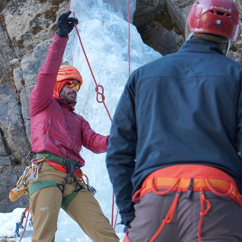 Colorado Mountain School Guide, Max Lurie, teaches a group of students how to tie knots for ice climbing during an Intro to Ice Climbing course in Rocky Mountain National Park.
