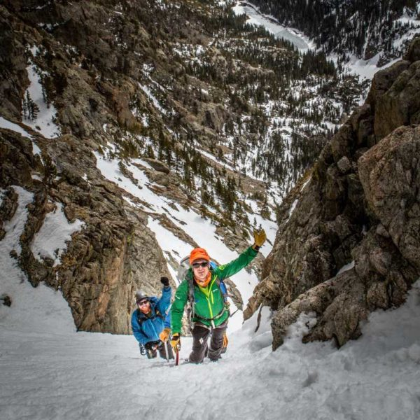 Three mountaineers ascend a snow couloir during the springtime in Rocky Mountain National Park.
