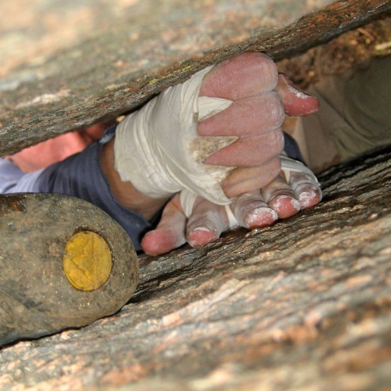 A climber used inverted technique, including heel-toe cams and a hand-fist stack to move up a wide crack in Vedauwoo, Wyoming.