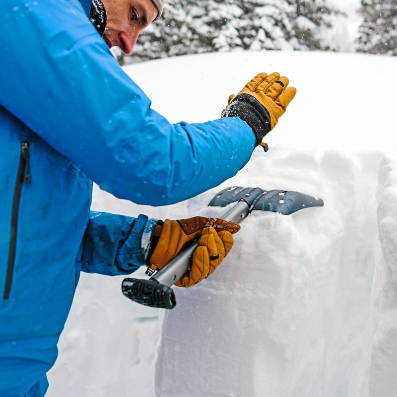 An avalanche instructor demonstrates how to perform an extended column test - a common test performed to assess snowpack instability.