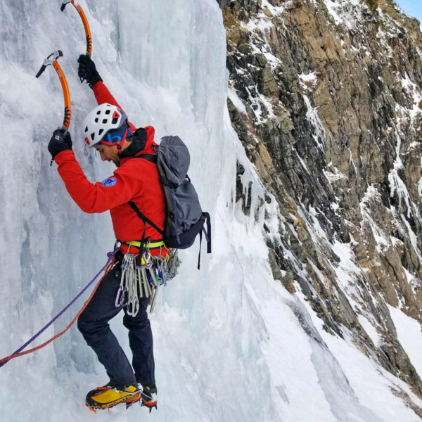 An ice climbing guide leads a pitch in Colorado during a lesson on a Learn to Lead Ice climbing class.