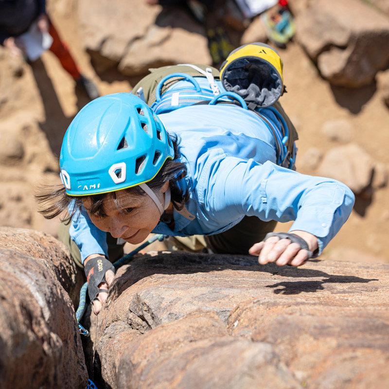 A rock climber leads a trad pitch during an Intro to Trad course near Denver, Colorado.