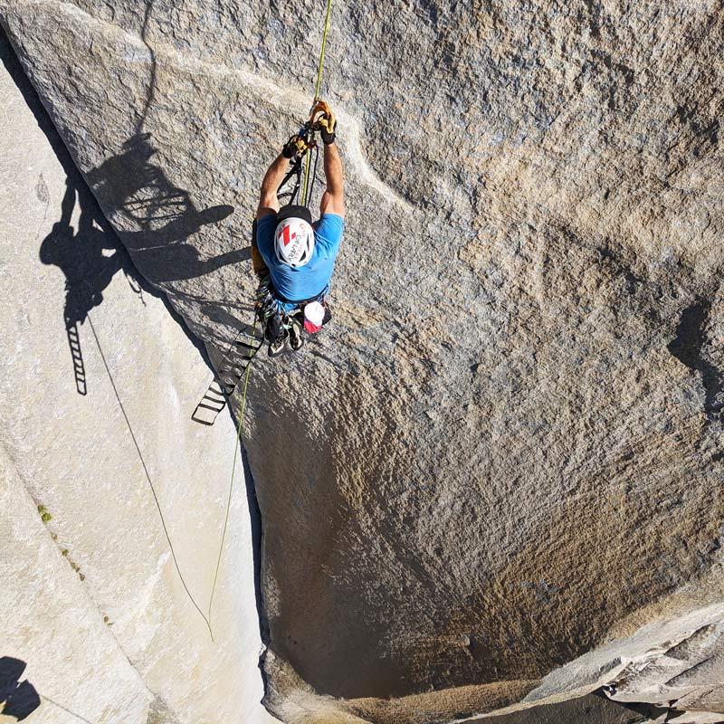 A big wall climber ascends a fixed line on El Capitan.