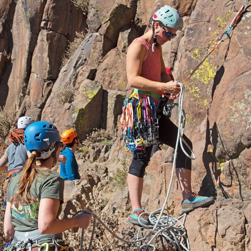 Students practice placing and clipping gear on a Learn to Lead Trad course at North Table Mountain, near Denver, Colorado.