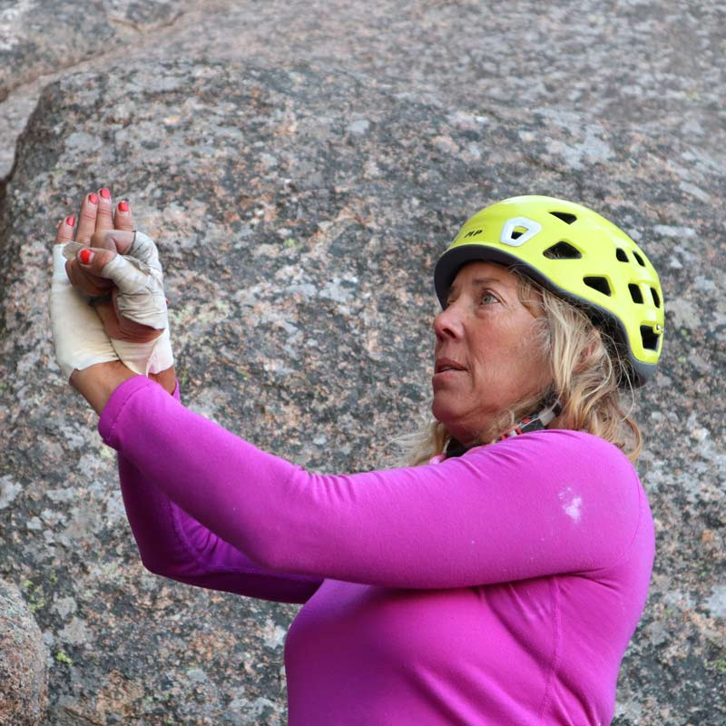 Colorado Mountain School Guide, Mia Tucholke, teaches off width climbing technique during a lesson in Vedauwoo, Wyoming.