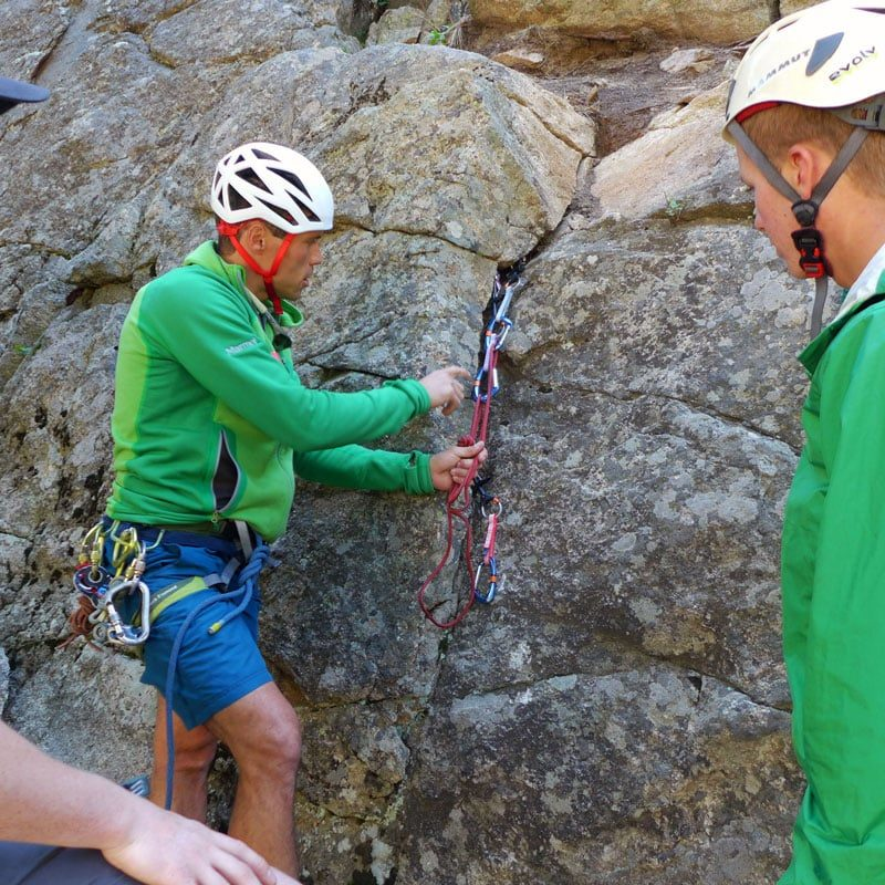 Certified Mountain Guide, Joey Thompson, demonstrates how to build a proper rock climbing anchor.