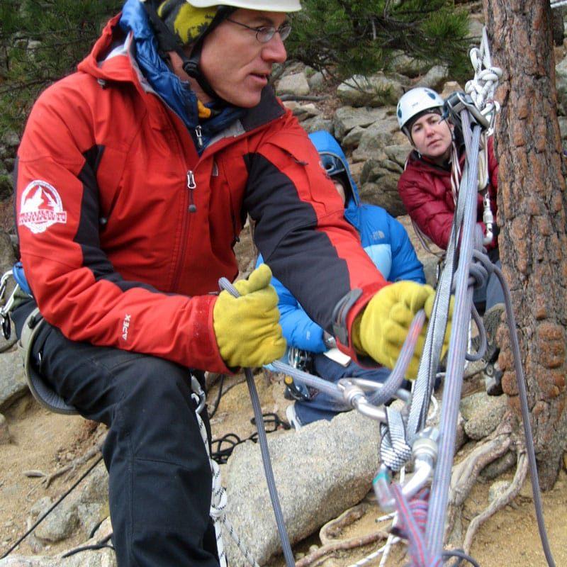 AMGA Guide demonstrates 3:1 pulley in a mock rock rescue scenario.