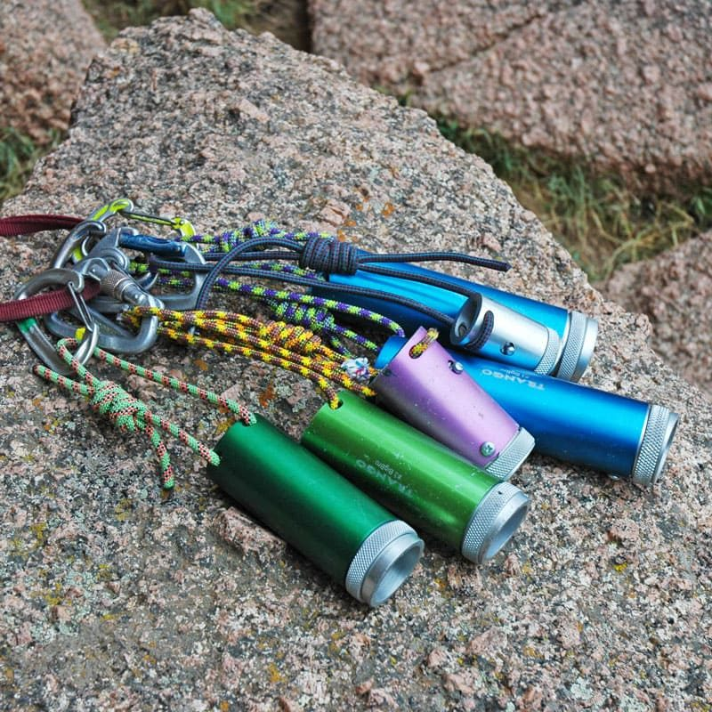 A rack of Trango Big Bros lie on a rock in Vedauwoo, Wyoming. These expandable tube chocks are used for protection on offwidth climbs and chimneys.