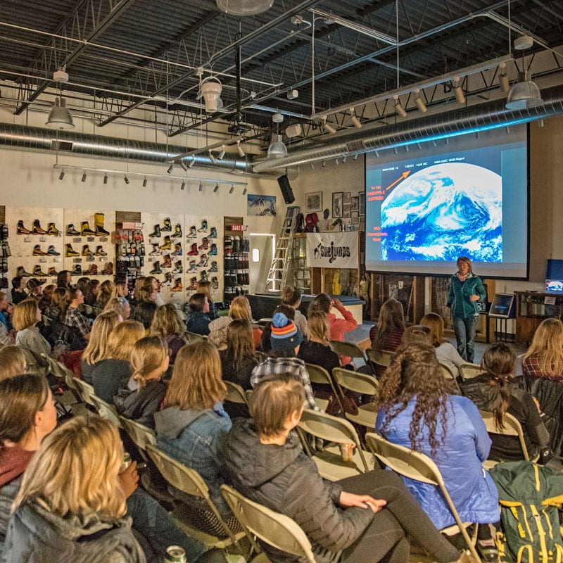A room full of people attending an avalanche clinic at Neptune Mountaineering.