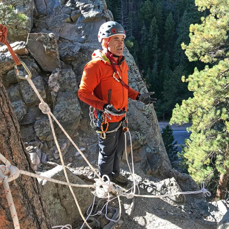 Steve Levin, AMGA SPI Instructor, discusses a top-rope anchor set up during a Single Pitch Instructor Exam.