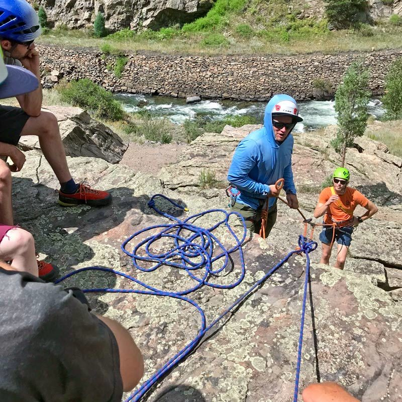 Students on an AMGA SPI Exam demonstrate an assisted raise during a mock climbing rescue scenario.