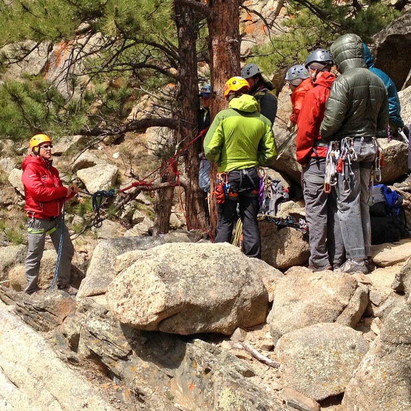 AMGA SPI Instructor demonstrates a top rope anchor in front of a group of aspiring climbing guides.