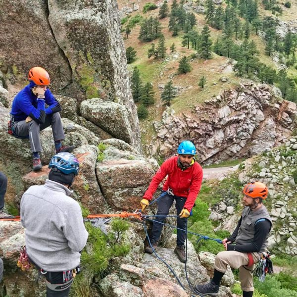 Aspiring climbing guides on an SPI Exam watch a top-managed climbing site demonstration by AMGA Instructor Japhy Dhungana.