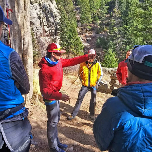 AMGA SPI Instructor demonstrates rope work to a group of aspiring climbing instructors
