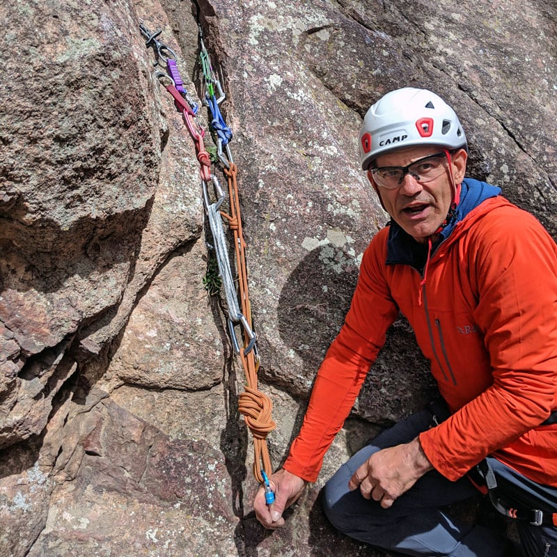 An AMGA Instructor teaches about rock climbing anchors on an AMGA Single Pitch Instructor (SPI) Course in Boulder, Colorado.