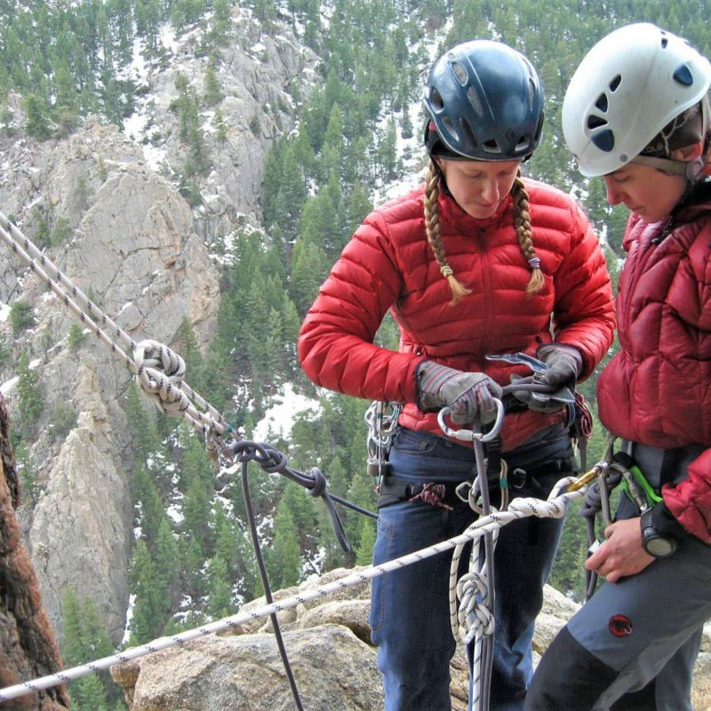 Students practice rock climbing rescues techniques on an AMGA Single Pitch Instructor Exam near Boulder, Colorado. AMGA SPI certification is a great first step toward becoming a mountain guide.
