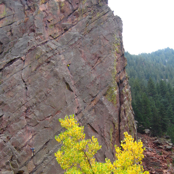 Two rock climbers make their way up the Bastille in Eldo.