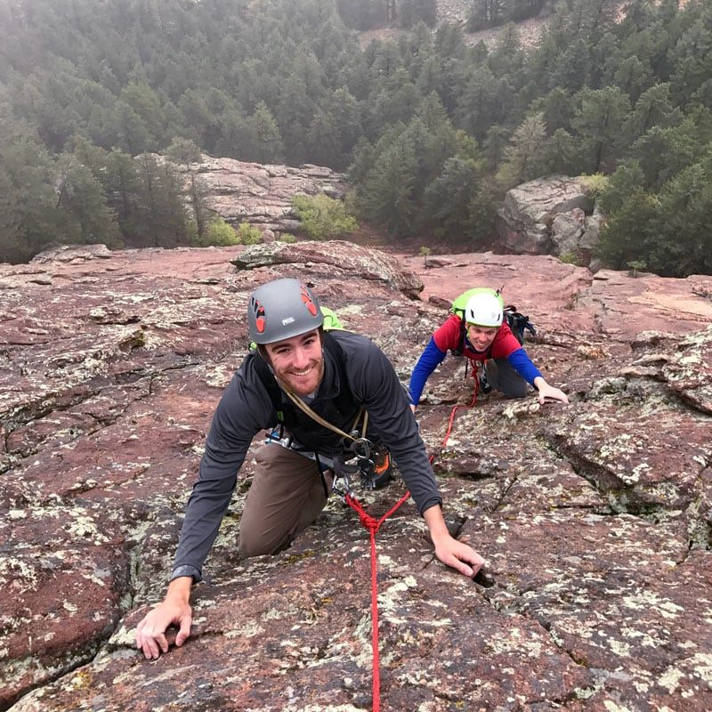 Two climbers ascending the second pitch of the First Flatiron, above Boulder, Colorado.