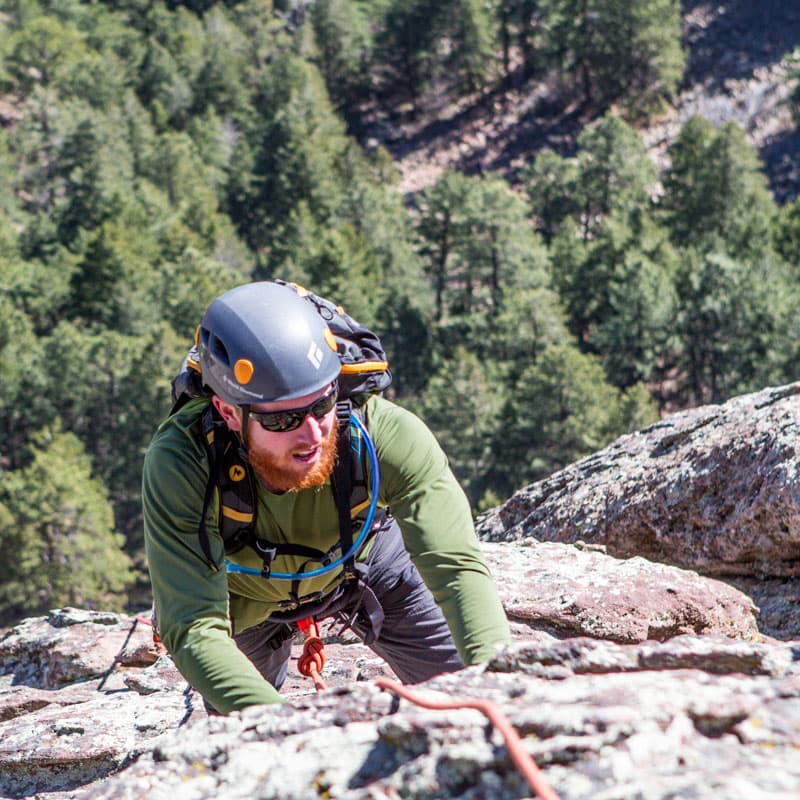 A rock climber ascends the East Face of the First Flatiron near Boulder Colorado.