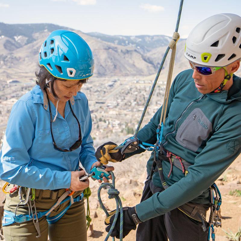 An AMGA SPI Instructor assists a student during an SPI Class near Denver, Colorado.