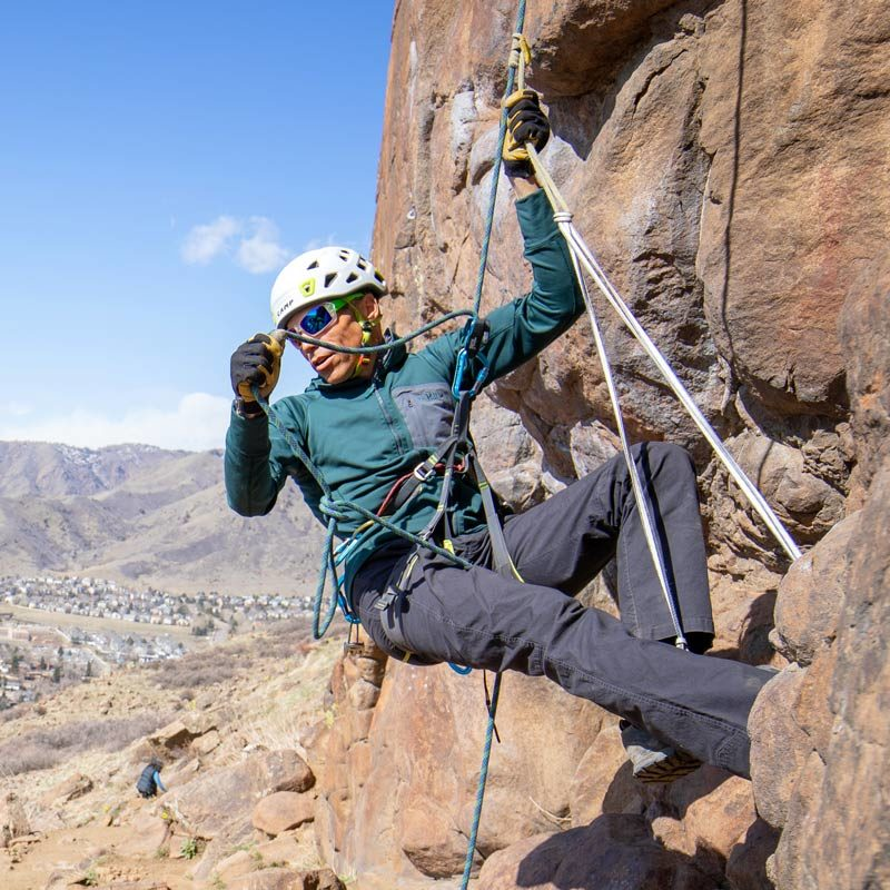 An instructor demonstrates how to ascend a rope during a lesson on an AMGA SPI course.