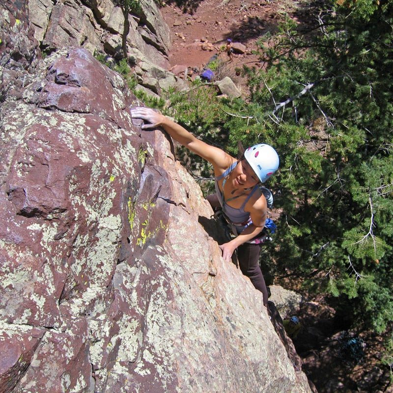 A rock climber leads a pitch on the West Ridge in Eldorado Canyon State Park.