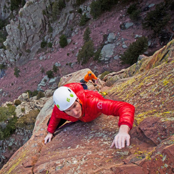 A rock climber leads the crux pitch on the Yellow Spur in Eldorado Canyon State Park.