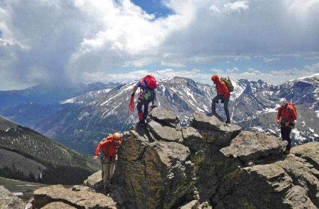 A group of mountain guides practice short-rope techniques high in the alpine in Rocky Mountain National Park.