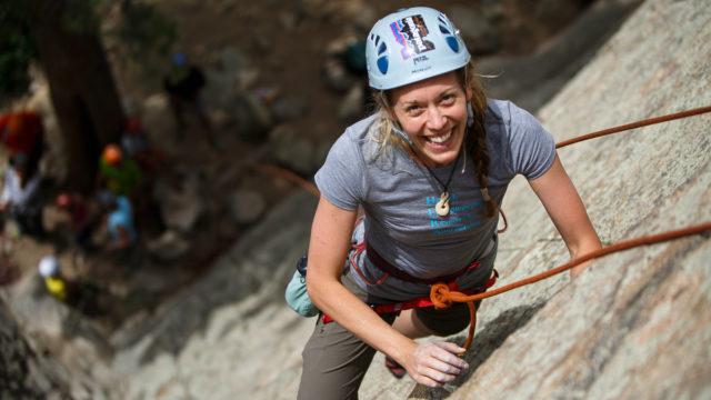 Rock climber scaling a rock on an Intro to Rock Climbing course in Boulder, Colorado