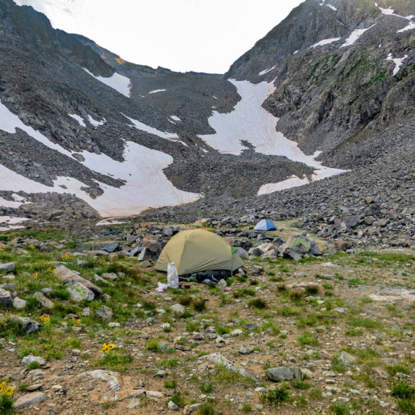 A couple of tents make up basecamp in a meadown on Castle Peak - one of Colorado's Fourteeners.