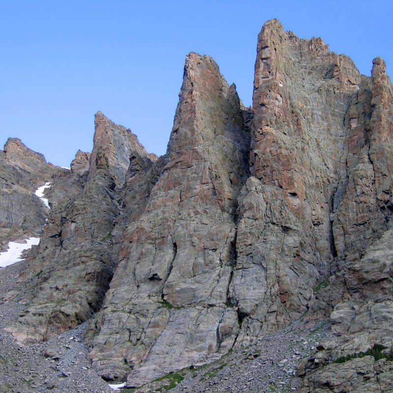 A view of the Petit Grepon from Sky Pond with Sharkstooth visible on the left and The Saber on the right.