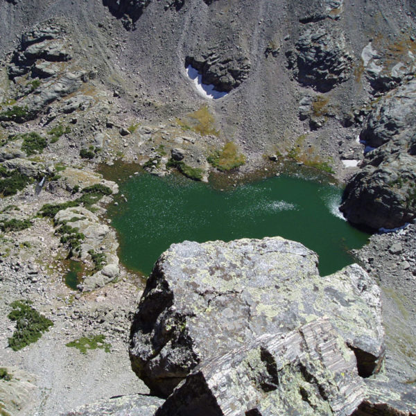 A view of Sky Pond from the tiny summit of the Petit Grepon in Rocky Mountain National Park.