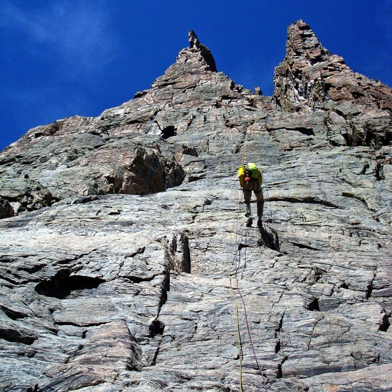 A rock climber rappels the final section of The South Face of The Petit Grepon in Rocky Mountain National Park.