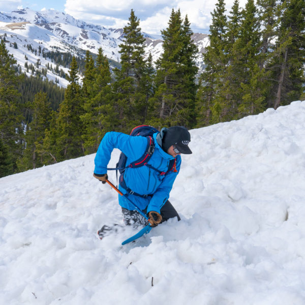 A student digs through avalanche debris in search of victims during a rescue training lesson on an AIARE 1 course near Denver, Colorado.