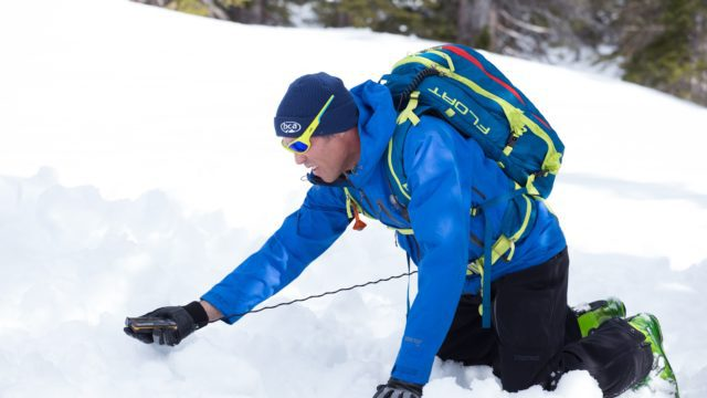 CMS Avalanche Program Director Joey Thompson performing a beacon search